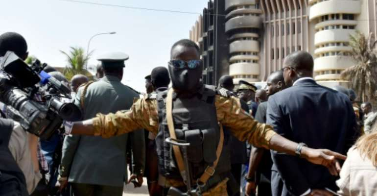 A police officer stands guard during a visit by Burkina Faso's and Benin's presidents to the Splendid hotel and the Capuccino cafe on January 18, 2016 in Ouagadougou.  By Issouf Sanogo (AFP)