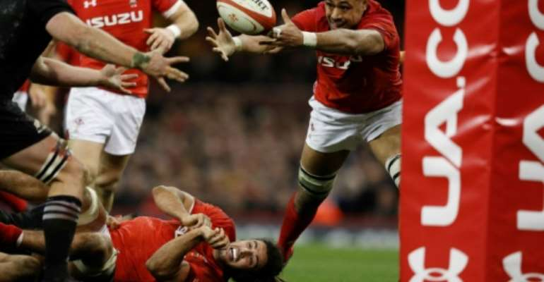 Wales' No. 8 Taulupe Faletau stretches for a loose ball during their rugby union Test match against New Zealand, at the Principality stadium in Cardiff, on November 25, 2017.  By Adrian DENNIS (AFP/File)