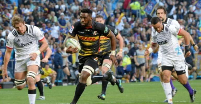 Western Province and Stormers captain Siya Kolisi makes a break against the Crusaders in a 2019 Super Rugby match.  By RODGER BOSCH (AFP/File)