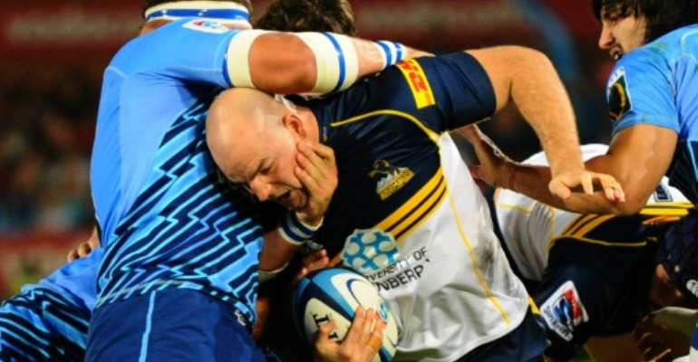Australian ACT Brumbies's hooker Stephen Moore (C) is tackled by a South African Northern Bulls's player during a Super 15 rugby union match, in Pretoria.  By Alexander Joe (AFP/File)