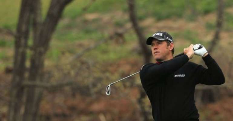 Westwood became the sixth golfer to successfully defend the title.  By Paul Lakatos (AFP/HO/File)