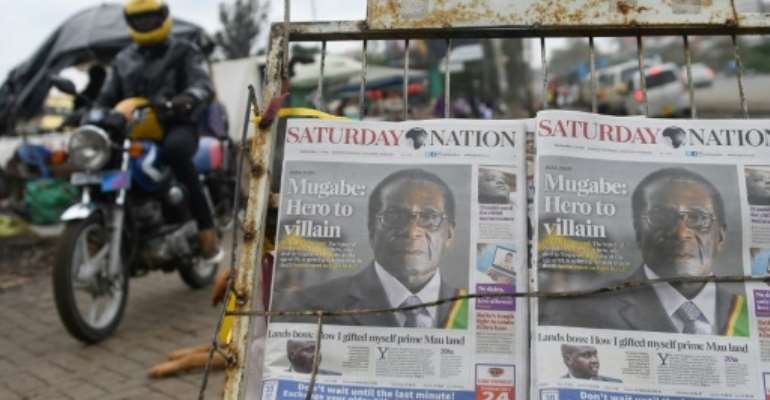 While Mugabe is hailed for having led Zimbabwe to independence, some people blame him for having wrecked the country's economy.  By SIMON MAINA (AFP)