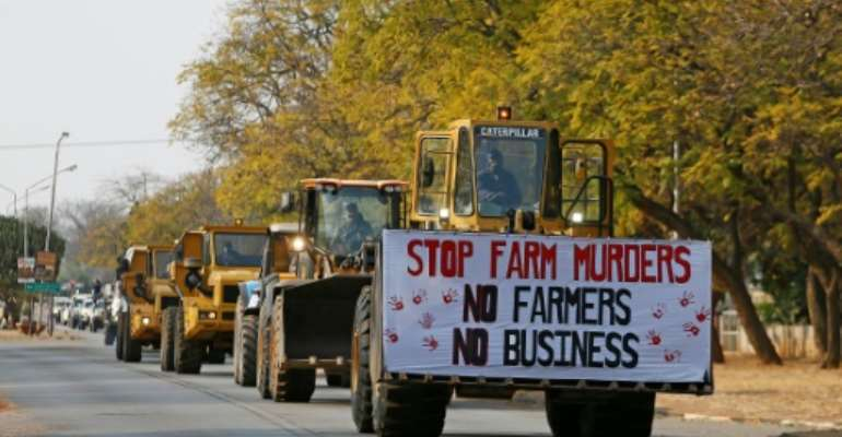 White farmers and their supporters have in recent months staged protests across the country against a spike in assaults and murders on farms..  By Phill Magakoe (AFP)