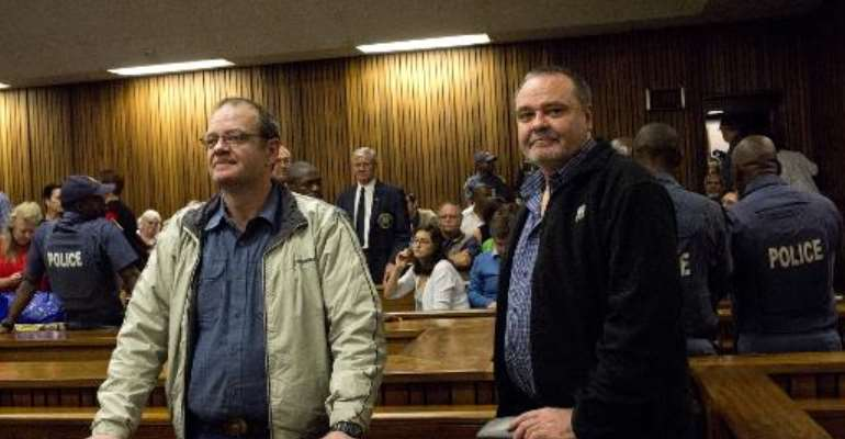 Mike (R) and Andre du Toit attend their trial at Pretoria High Court on October 29, 2013.  By Alexander Joe (AFP)
