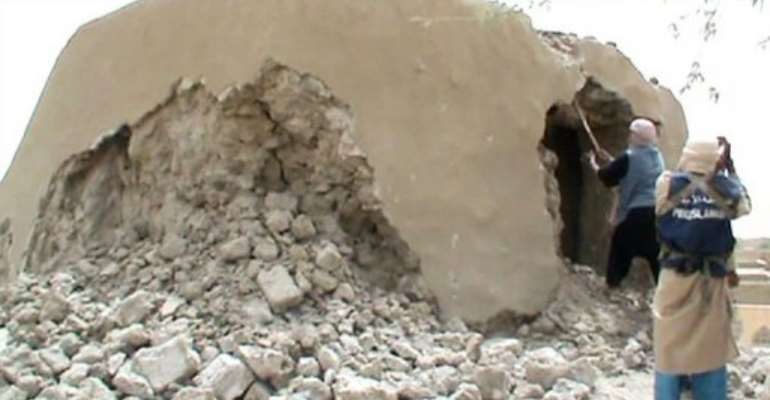 A still from a video shows Islamist militants destroying an ancient shrine in Timbuktu on July 1.  By  (AFP/File)