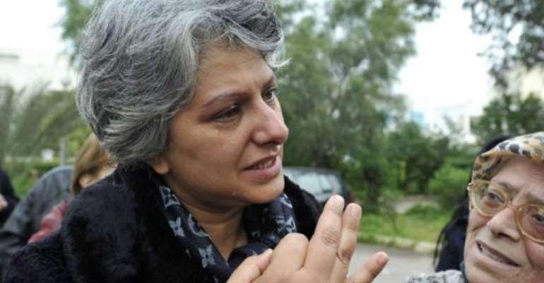 Basma Belaid, widow of murdered opposition figure Chokri Belaid, weeps as she speaks on February 18, 2013 in Tunis.  By Fethi Belaid (AFP/File)