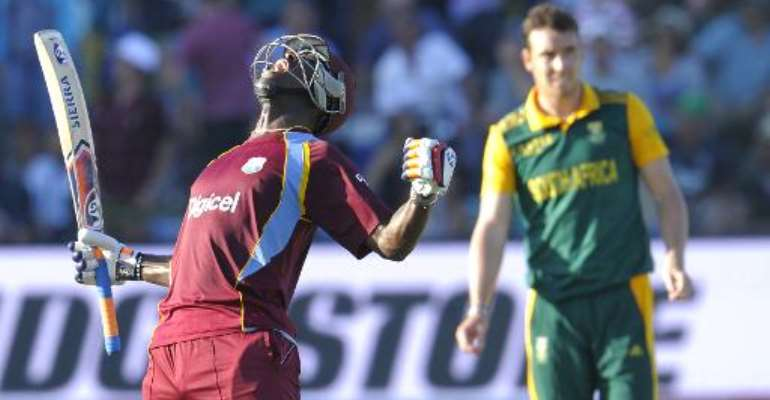West Indies batsman Andre Russell (L) celebrates after they beat South Africa by one wicket during the fourth one-day international at St. George's Park in Port Elizabeth on January 25, 2015.  By Gianluigi Guercia (AFP)