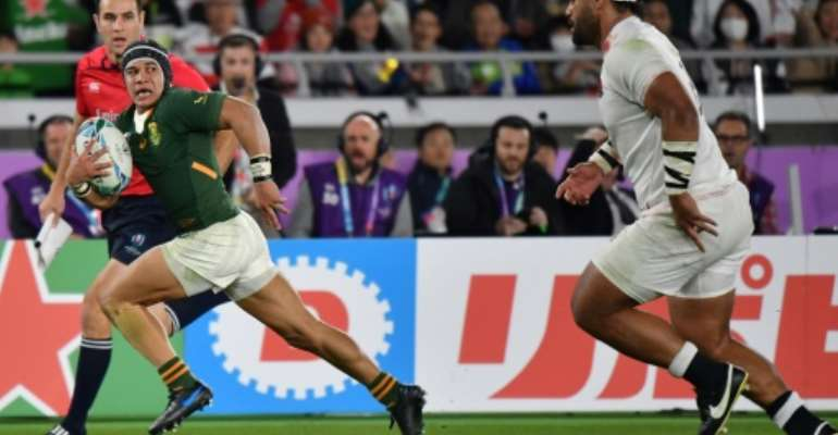 Wing Cheslin Kolbe (L) was a major star for South Africa at last year's World Cup.  By Kazuhiro NOGI (AFP)