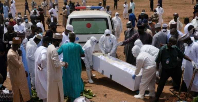 Workers bury Abba Kyari, chief of staff to President Muhammadu Buhari, who died from coronavirus in April.  By Kola Sulaimon (AFP)