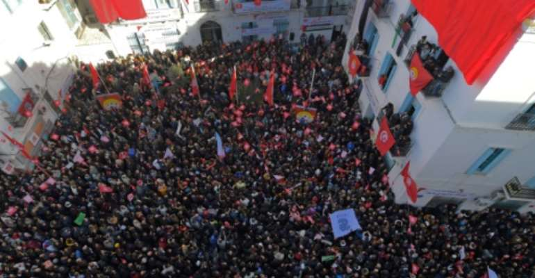 Workers gather at the headquarters of the powerful Tunisian General Labour Union during a strike on January 17, 2019.  By FETHI BELAID (AFP)