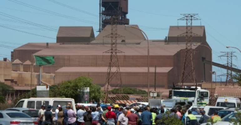 Workers protest outside the Arcellor Mittal Saldanha steel plant against the planned closure of the operation which would result in 900 jobs lost.  By RODGER BOSCH (AFP)