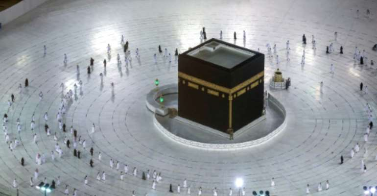 Worshippers circumambulate the Kaaba in the Grand Mosque complex in the Saudi city of Mecca, on October 4, 2020, as authorities partially resume the year-round umrah for a limited number of pilgrims amid the coronavirus pandemic.  By - (AFP)