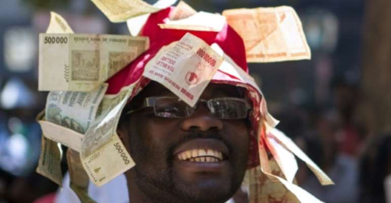 Wracked by economic crises and hyperinflation that saw it introduce various currencies that quickly lost value, Zimbabwe has not paid its foreign debt for years.  By ZINYANGE AUNTONY (AFP/File)