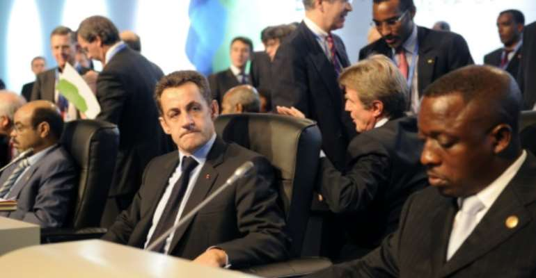 Yankuba Touray is seen here, right, at a European-African summit in Lisbon in December 2007, when he was fisheries and natural resources minister. Also seen: former French president Nicolas Sarkozy, centre, and Ethiopian ex-premier Meles Zenawi, left.  By ERIC FEFERBERG (AFP/File)