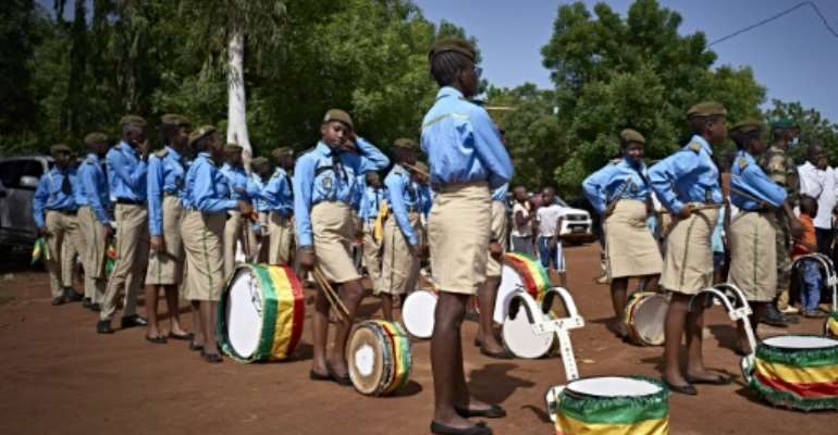 Young musicians get ready for the parade at the ceremony marking the anniversary of Mali's independence in Bamako.  By MICHELE CATTANI (AFP)
