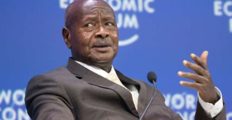Yoweri Museveni's genial face and penchant for folksy parables belie a past as a wily guerilla fighter and ruthless political survivor..  By RODGER BOSCH (AFP/File)