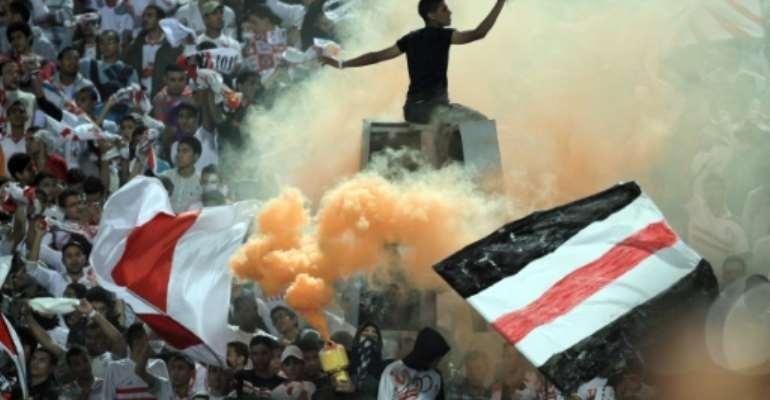 Egyptian fans of Zamalek club celebrate during a match on November 10, 2011.  By Khaled Desouki (AFP/File)