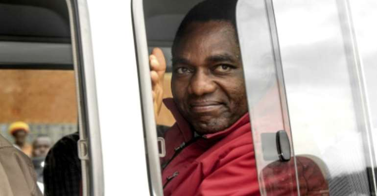 Zambian opposition leader Hakainde Hichilema, seen waving to supporters from a police van in April and facing treason charges, has been transferred to a maximum security jail outside the capital Lusaka.  By DAWOOD SALIM (AFP/File)