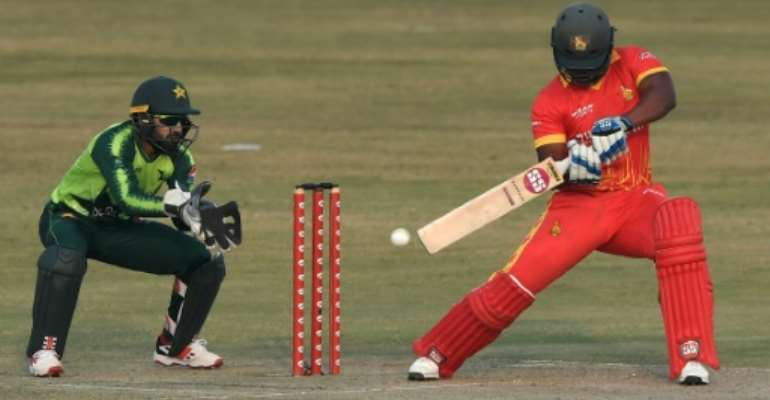 Zimbabwe captain Chamu Chibhabha plays a shot as Pakistan's wicketkeeper Mohammad Rizwan stands by during their third Twenty20 cricket match in Rawalpindi.  By Aamir QURESHI (AFP)
