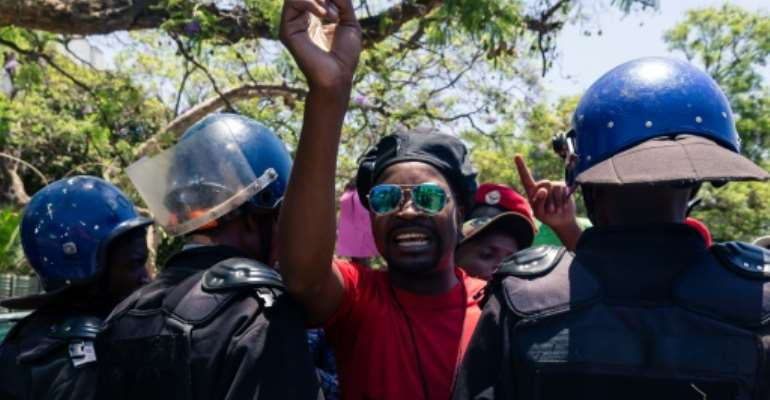 Zimbabwe civil servants marched in a rally against low wages in Harare, heavily guarded by anti-riot police.  By Jekesai NJIKIZANA (AFP)