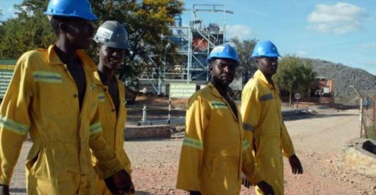 Miners return from a shift underground in Zvishavane.  By Jekesai Njikizana (AFP/File)