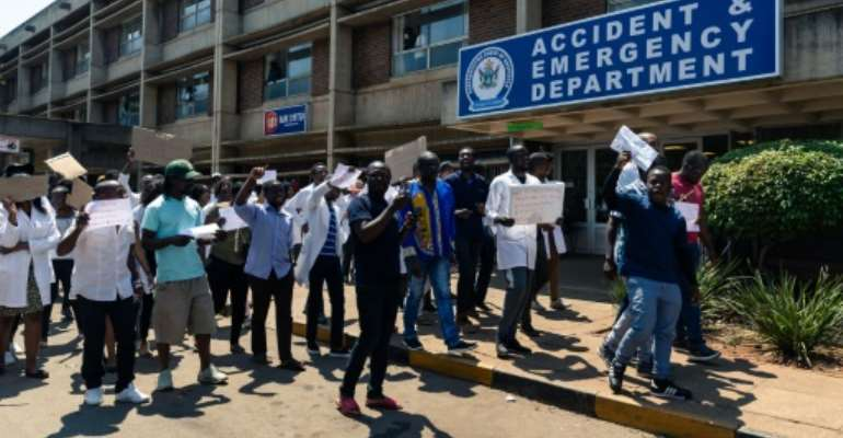 Zimbabwe junior doctors protested Sunday over the abduction of their union's leader, Dr Peter Magombeyi.  By Jekesai NJIKIZANA (AFP)
