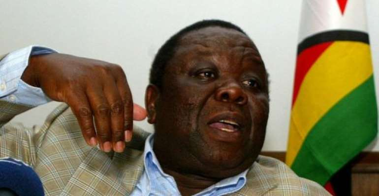 Zimbabwe Prime Minister Morgan Tsvangirai speaks to media during a press conference in Harare, on September 28, 2011.  By Jekesai Njikizana (AFP/File)