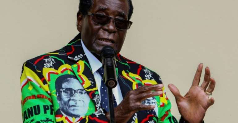 Zimbabwe President Robert Mugabe speaks at the party's annual conference on December 17, 2016 in Masvingo.  By Jekesai NJIKIZANA (AFP/File)