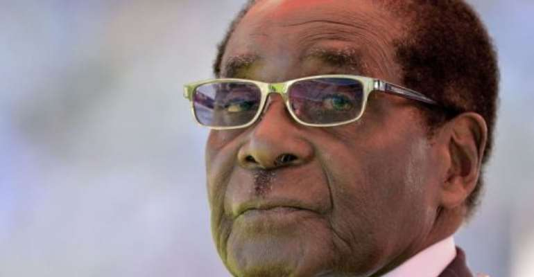 Zimbabwean President Robert Mugabe looks on during his inauguration and swearing-in on August 22, 2013 in Harare.  By Alexander Joe (AFP/File)