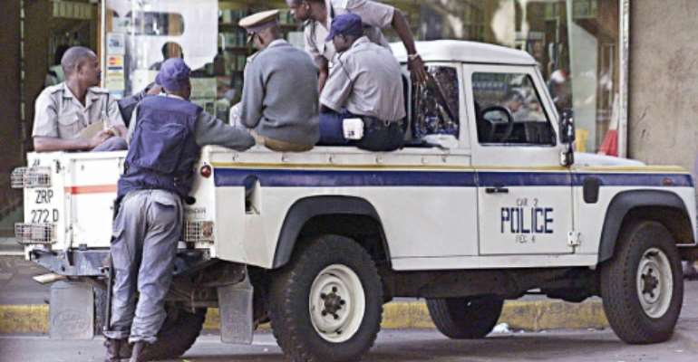 Zimbabwean police on patrol in Harare.  By DESMOND KWANDE (AFP/File)