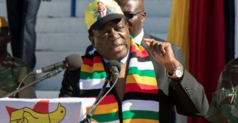 Zimbabwean President Emmerson Mnangagwa, pictured on July 21, 2018, has vowed to hold a peaceful and fair vote, but there is growing concern over alleged voter intimidation ahead of the eleciton.  By Wilfred Kajese (AFP)