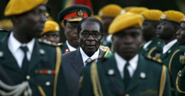 Zimbabwean President Robert Mugabe was left a 'broken soul' when the army turned against him in 2017.  By ALEXANDER JOE (AFP)
