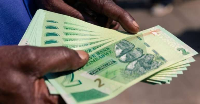 Zimbabwe's economy has been crippled by decades of mismanagement under Mugabe. Galloping hyperinflation has left many struggling with the cost of living.  By Jekesai NJIKIZANA (AFP)
