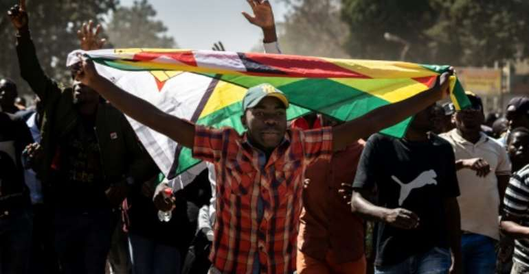 Zimbabwe's opposition has warned of more demonstrations this year to force political and economic change.  By Zinyange Auntony (AFP)