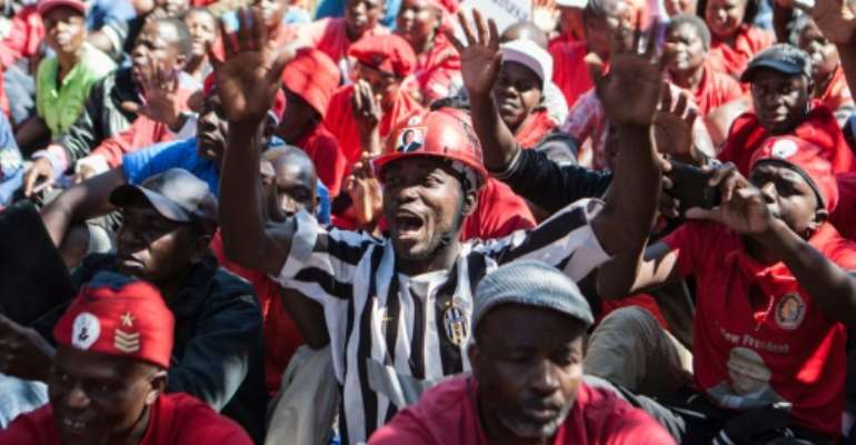 Zimbabwe's opposition party Movement for Democratic Change (MDC) supporters shout anti-government slogans during a demonstration in Gweru, on August 13, 2016.  By Zinyange Auntony (AFP)
