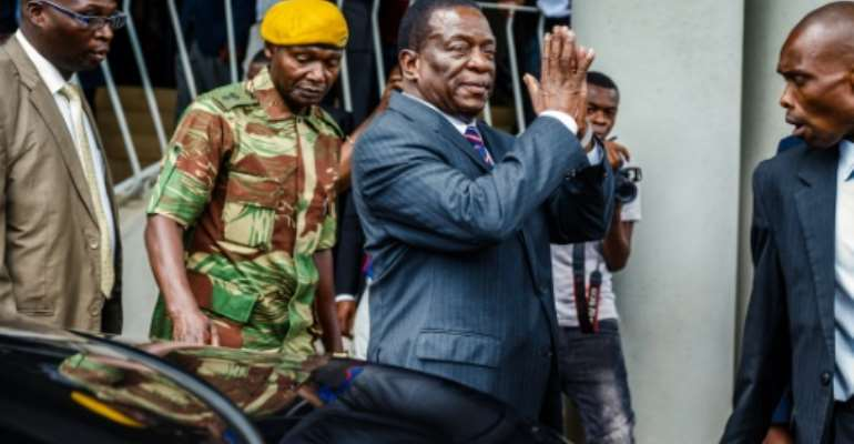 Zimbabwe's President Emmerson Mnangagwa arrives for a visit at the home of late opposition leader Morgan Tsvangirai, who died in South Africa last week, to express his condolences to the family..  By Jekesai NJIKIZANA (AFP)