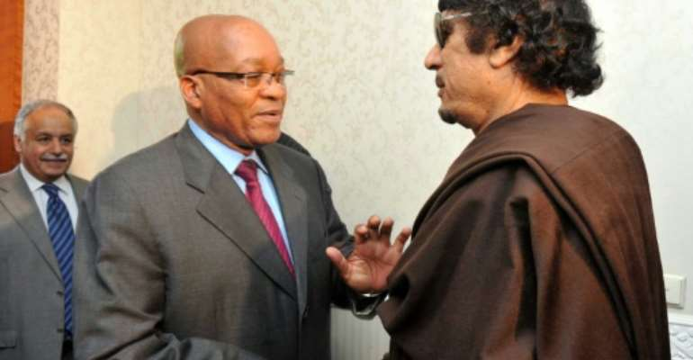 Zuma, left, pictured with Kadhafi on May 30 2011, when he made a one-day visit to Tripoli as head of an African Union delegation mediating in the Libyan crisis. Zuma has denied a newspaper report that he was given $30 million by Kadhafi for 'safe keeping'.  By Ntswe Mokoena (South African government/AFP)