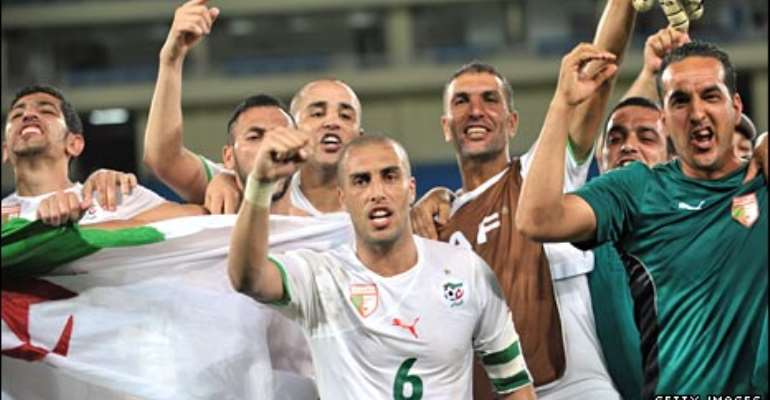 Algeria's players celebrate their famous victory in Cabinda