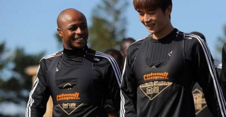 Andre Ayew and a teammate sharing jokes ahead of Friday's training