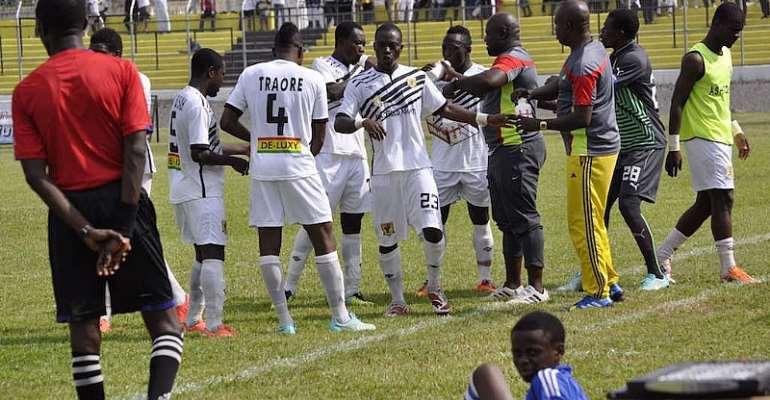 AshantiGold players and officials.