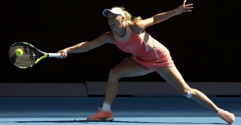 Caroline Wozniacki crashes out at Australian Open, Novak Djokovic and Serena Williams cruise through