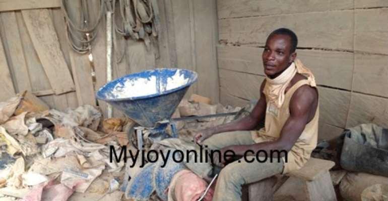 A miner at his shop