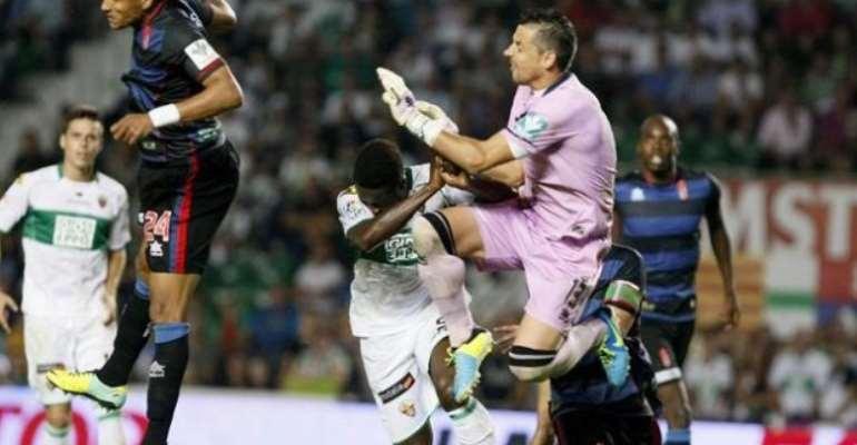 Richmond Boakye collapsed after crashing with Granada goalkeeper Roberto