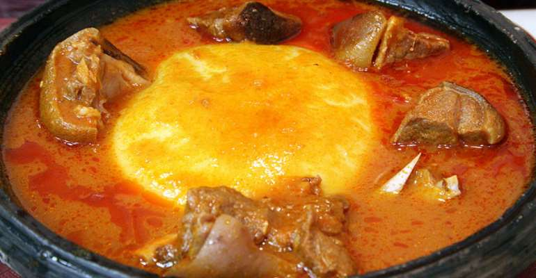 Fufu with light soup and meat