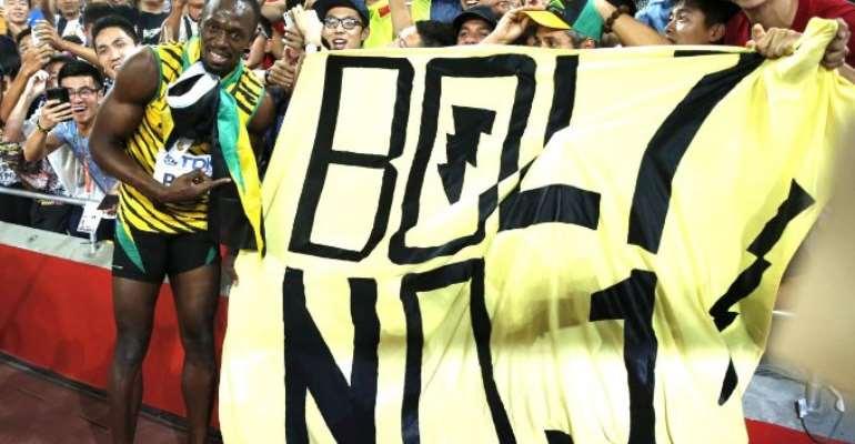 Bolt produces magic to upset Gatlin in 100m world final