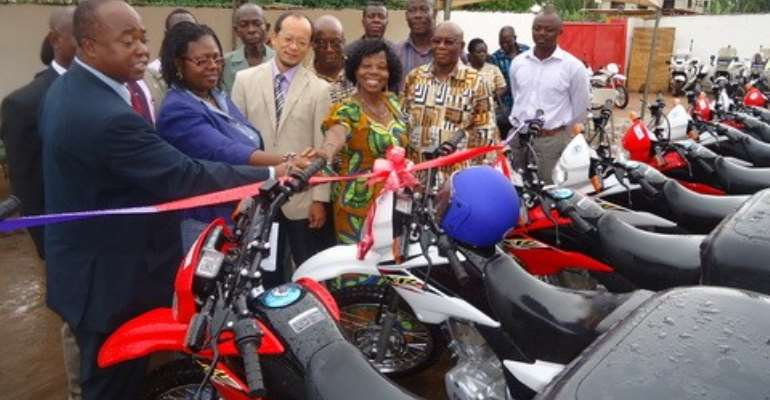 Mr. Stephen Adu, Dep. D-G of GES (first left) receiving the motobikes from Mr. Koichi Kito of JICA, while other GES officials assist in the process