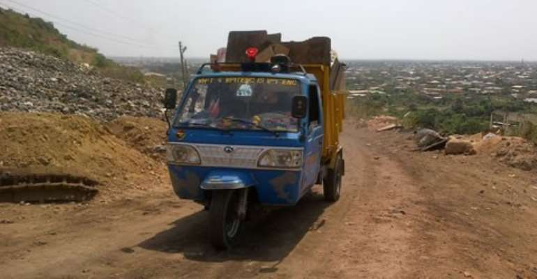 A vehicle heading to the dump site to offload refuse