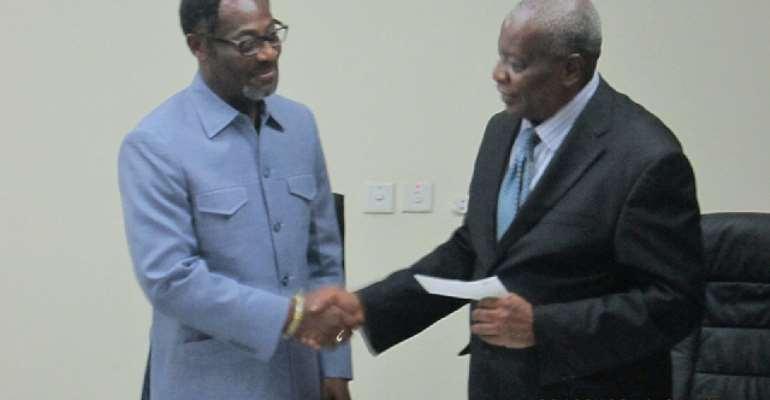 Drolor Bosso Adamtey I, Chancellor of UPSA, handed the cheque to Justice Nii Aryeetey, UPSA Governing Council Chairman