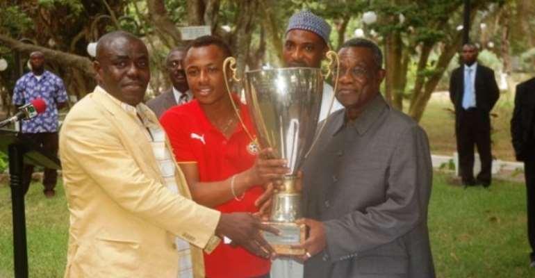 Victorious Satellites present trophy to President Atta Mills
