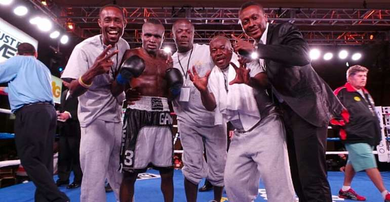 Emmanuel Tagoe with his trainers and manager Baffour Gyan after the fight